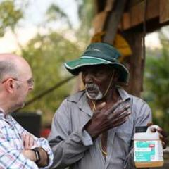 Photo: Michael Furlong. Talking with a farmer in Fiji about the problems associated with using pesticides
